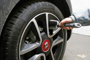 A car wheel and tire brush