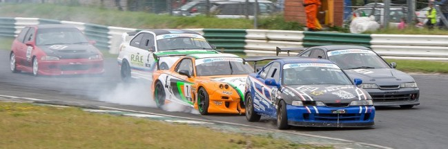 Rob Savahe leads a typical ITCC scrap into Turn One