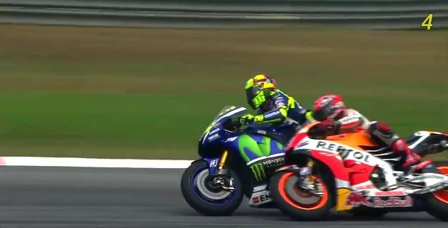 2nd point of contact. Rossi pushes back with his knee.