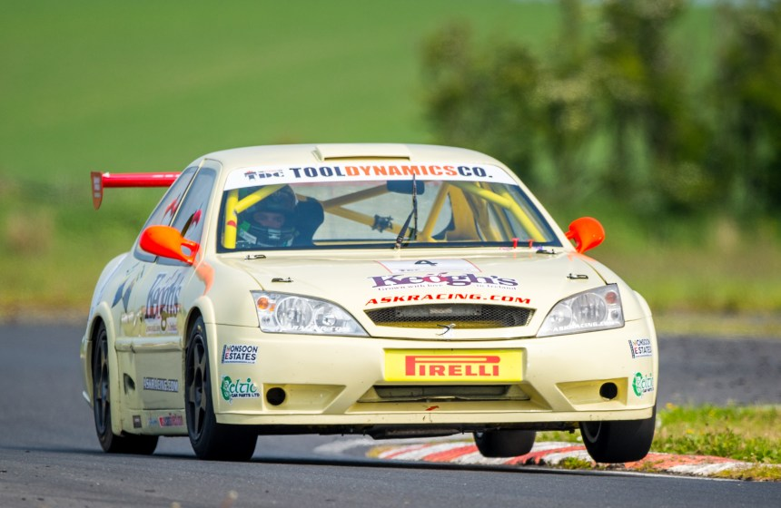Turkington two wheels the Keogh's Crisps car through the chicane