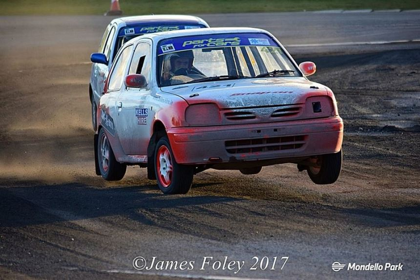 Junior winner Harding catches some air at the final corner. Image from James Foley