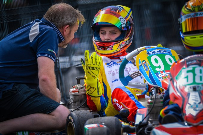Alyx Coby talks to her father, Gary, as she prepares to take to take to the track at Round 5 of the Motorsport Ireland Karting Championship at Nutts Corner Circuit.