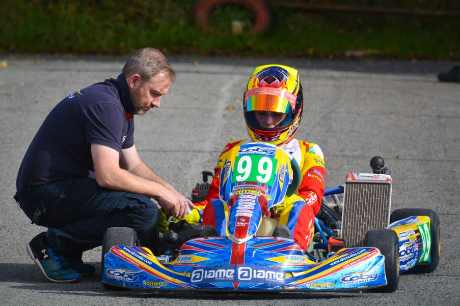 Alyx Coby with her father, Gary, at Round 9 of the Motorsport Ireland Karting Championship. Photo: Marc Quinlivan