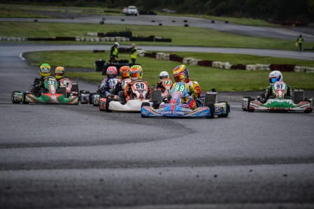 Alyx Coby leads the field into the first corner at Round 9 of the Motorsport Ireland Karting Championship. Photo: Marc Quinlivan