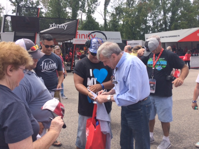 Ken Squier signs autographs for fans at the O'Reilly Auto Parts display at Darlington Raceway September 1-3