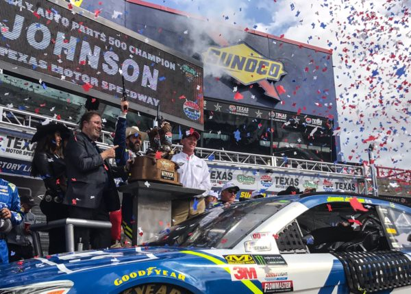 Johnson claims lucky #7 during the O'Reilly Auto Parts 500 at Texas Motor Speedway