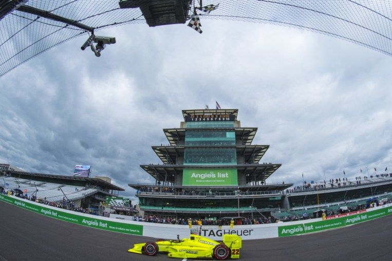 Simon Pagenaud(22) crosses the yard of bricks to win the Angie's List Grand Prix of Indianapolis at Indianapolis Motor Speedway, Saturday, May. 14, 2016, in Indianapolis, IN. (Tribute Racing/Matthew Bishop)