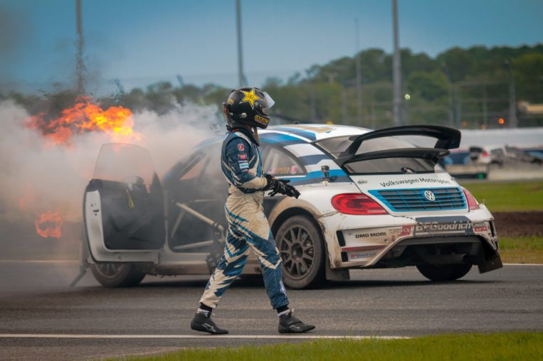 Scott Speed inspects his car after it caught on fire at the end of the first Red Bull Global Rallycross Supercars final at Daytona International Speedway on June 18, in Daytona Beach, FL