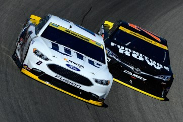 JOLIET, IL - SEPTEMBER 18: Brad Keselowski, driver of the #2 Miller Lite Ford, races Martin Truex Jr, driver of the #78 Furniture Row/Denver Mattress Toyota, during the NASCAR Sprint Cup Series Teenage Mutant Ninja Turtles 400 at Chicagoland Speedway on September 18, 2016 in Joliet, Illinois. (Photo by Robert Laberge/Getty Images)