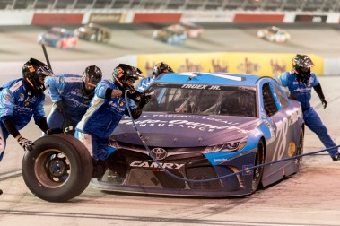 Martin Truex Jr. gets service on the last pit stop of the night during the 2016 Southern 500 in Darlington, Sc, Sunday, September 4, 2016.