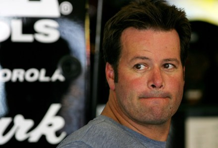 FONTANA, CA - AUGUST 31: Robby Gordon, driver of the #7 Original Road House Grill/Jim Beam Chevrolet, stands in the garage prior to practice for the NASCAR Nextel Cup Series Sharp Aquos 500 at California Speedway on August 31, 2007 in Fontana, California.  (Photo by Robert Laberge/Getty Images for NASCAR)