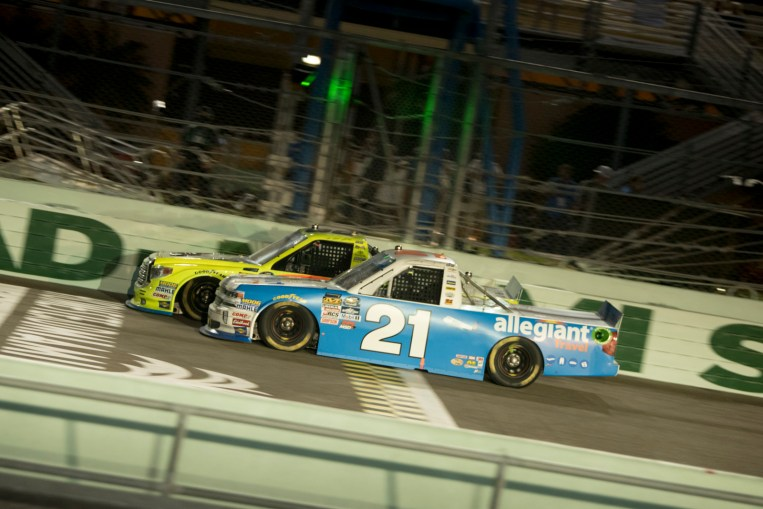 The championship contenders battle down the front stretch during the Ford Ecoboost 200 at Homestead-Miami Speedway.