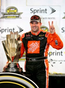 HOMESTEAD, FL - NOVEMBER 20: Tony Stewart, driver of the #20 Home Depot Chevrolet, celebrates winning the NASCAR Nextel Cup Championship after the Ford 400 on November 20, 2005 at Homestead-Miami Speedway in Homestead, Florida. (Photo By Streeter Lecka/Getty Images)