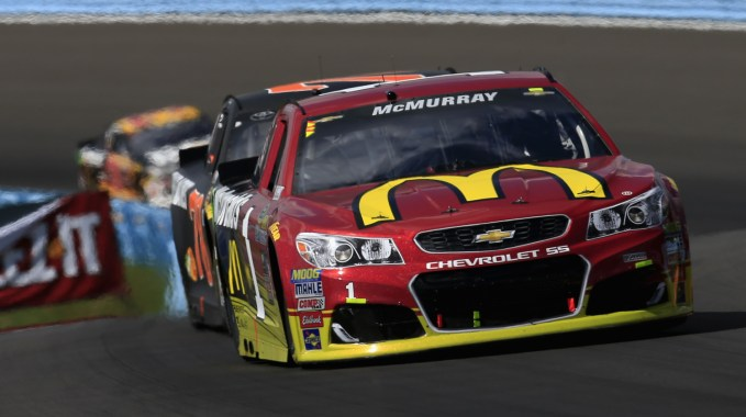 WATKINS GLEN, NY - AUGUST 07:  Jamie McMurray, driver of the #1 McDonald's Chevrolet, leads Martin Truex Jr., driver of the #78 Furniture Row Toyota, during the NASCAR Sprint Cup Series Cheez-It 355 at Watkins Glen International on August 7, 2016 in Watkins Glen, New York.  (Photo by Chris Trotman/Getty Images)