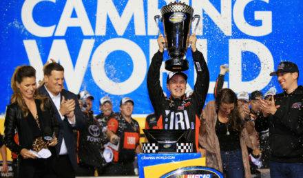 HOMESTEAD, FL - NOVEMBER 17:  Christopher Bell, driver of the #4 JBL Toyota, celebrates with the trophy in Victory Lane after placing second and winning the Camping World Truck Series Championship during the NASCAR Camping World Truck Series Championship Ford EcoBoost 200 at Homestead-Miami Speedway on November 17, 2017 in Homestead, Florida.  (Photo by Chris Trotman/Getty Images)