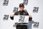 FORT WORTH, TX - NOVEMBER 03:  Justin Haley, driver of the #24 Zeality Chevrolet, poses with the 21 Means 21 Pole Award after qualifying for the pole position for the NASCAR Camping World Truck Series JAG Metals 350 Driving Hurricane Harvey Relief at Texas Motor Speedway on November 3, 2017 in Fort Worth, Texas.  (Photo by Matt Sullivan/Getty Images for Texas Motor Speedway)
