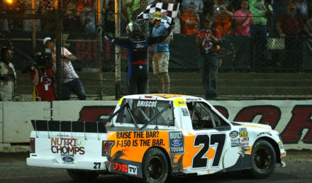 ROSSBURG, OH - JULY 18:  Chase Briscoe, driver of the #27 Ford Ford, celebrates with the checkered flag after winning the NASCAR Camping World Truck Series Eldora Dirt Derby at Eldora Speedway on July 18, 2018 in Rossburg, Ohio.  (Photo by Matt Sullivan/Getty Images)
