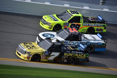 Three-wide battle between Korbin Forrister (7), Brett Moffitt (24) and Matt Crafton (88) during NextEra Energy Resources 250 opening practice.