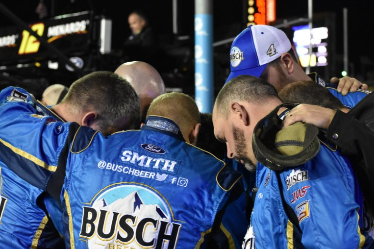 One last team prayer from Kevin Harvick's No. 4 pit crew before heading into action.