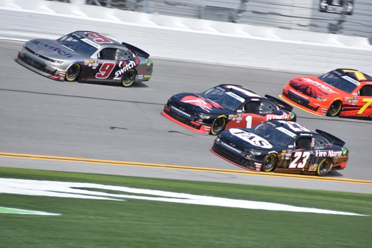 Noah Gragson (9) leads the top groove and close of clearing Michael Annett (1) and John Hunter Nemechek (23).