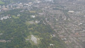 Seen from the airplane, a large green park on the right, this is Kew Gardens, surrounded by residential (Photo credit Jill Browne)
