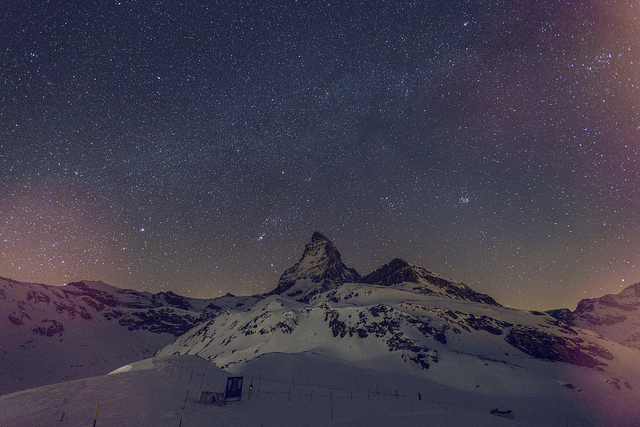 Stary sky with snowy mountain scenery, including Matterhorn