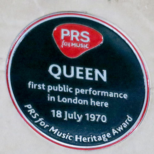Benny Hill lived here and Queen played their first public gig over here, historic plaques in London, England