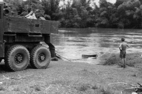 The Landrover emerges from Tamparuli River, May 1960