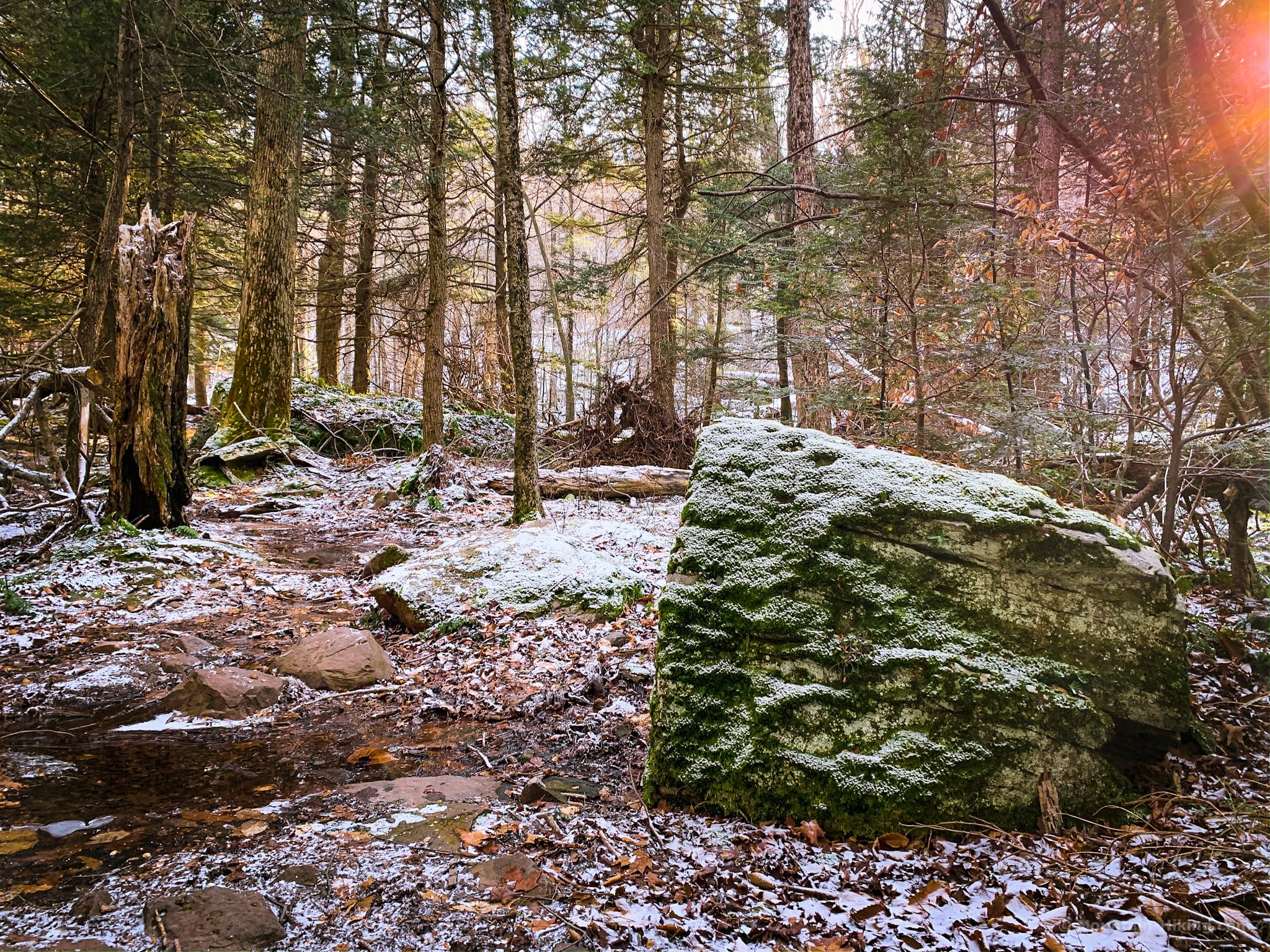 snow covered boulder on the devil's path
