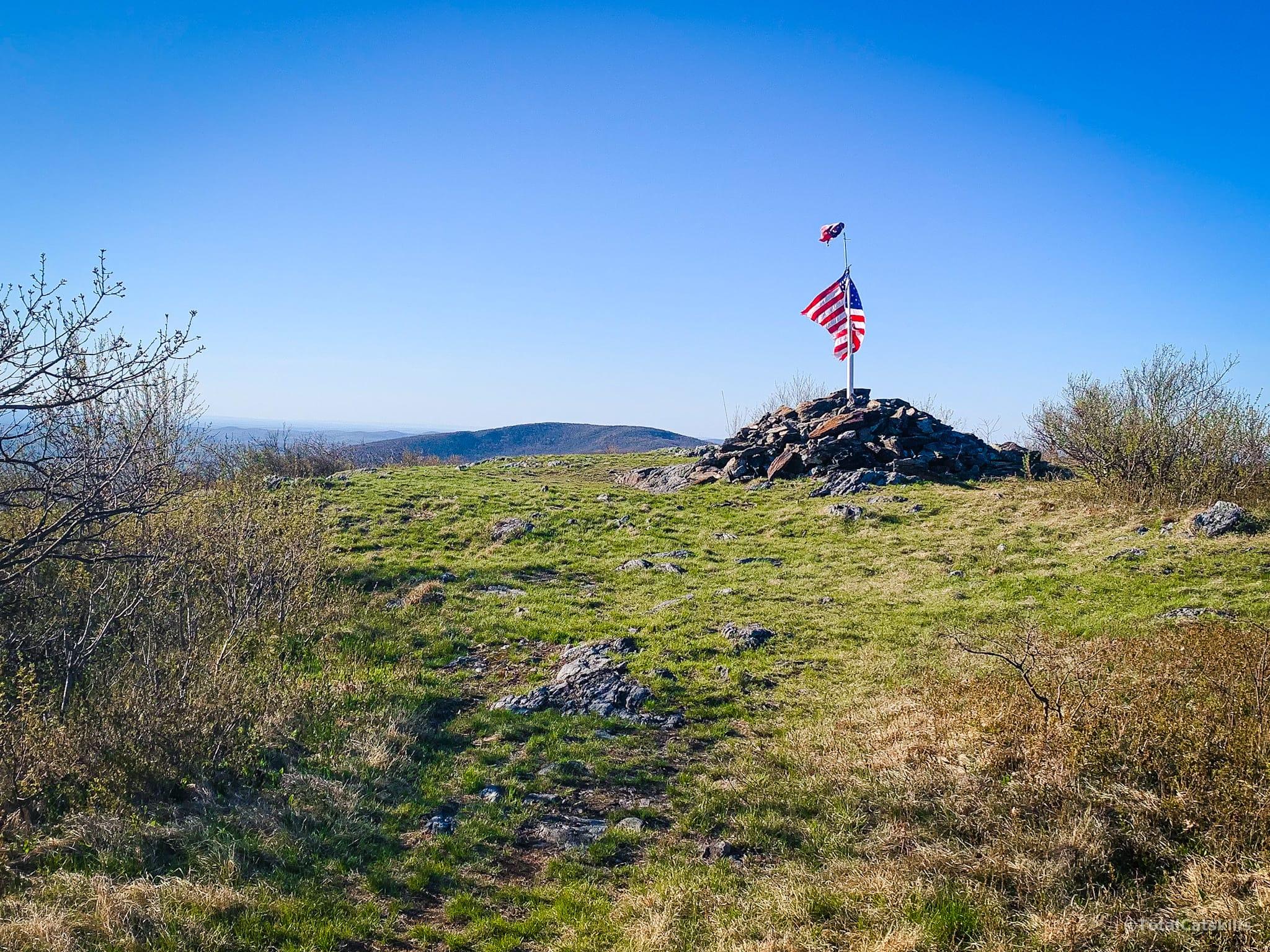 american flag on summit cairn