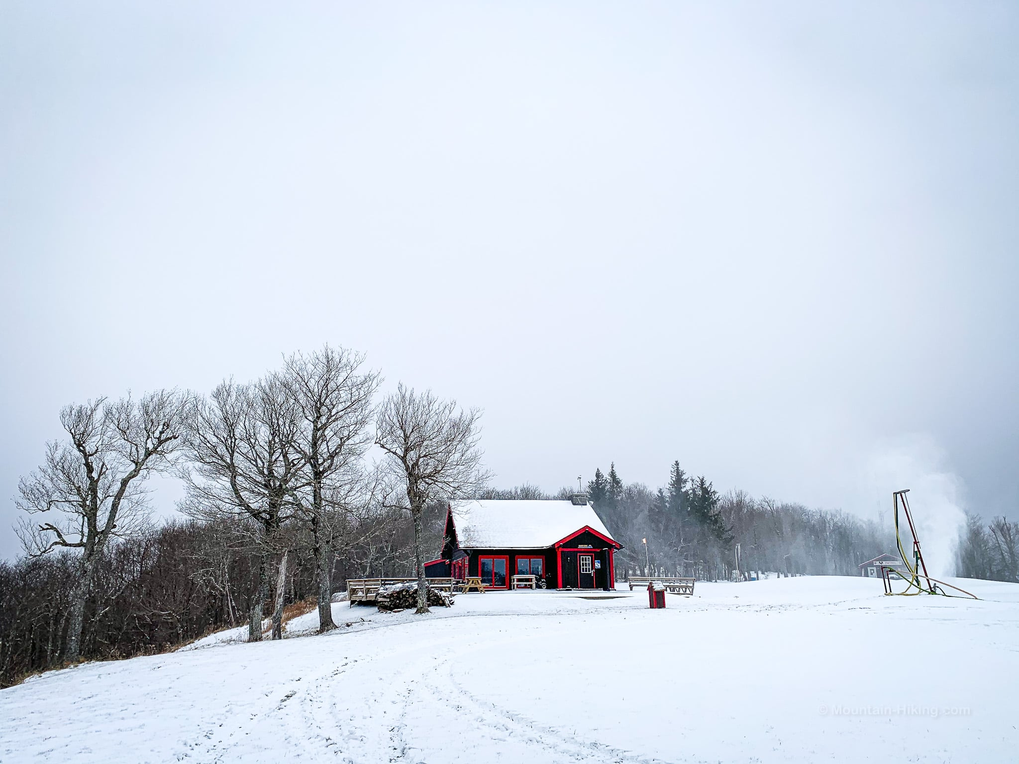 red-trimmed building in snow