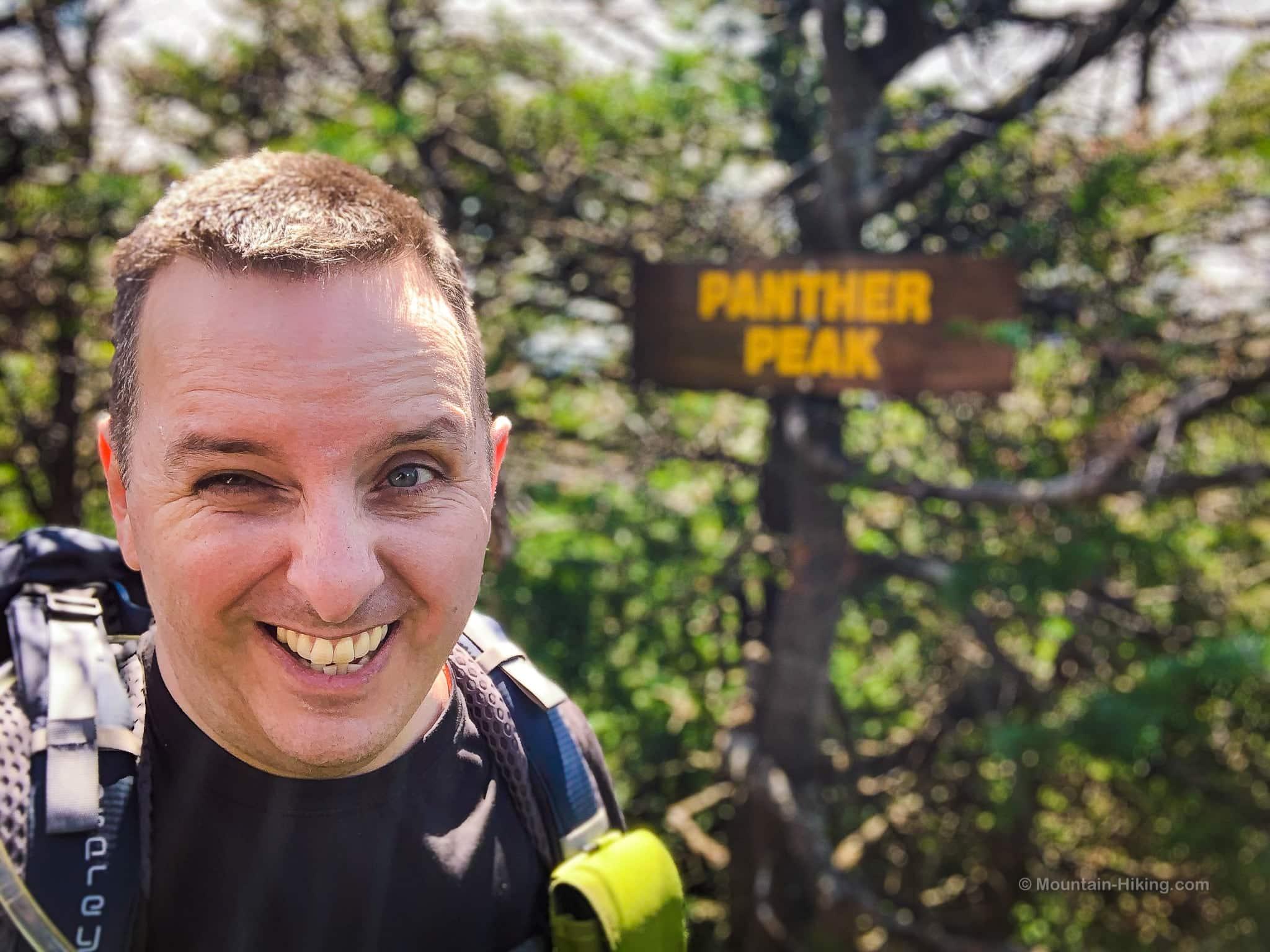 Hiker at summit of Panther Peak in the Adirondacks