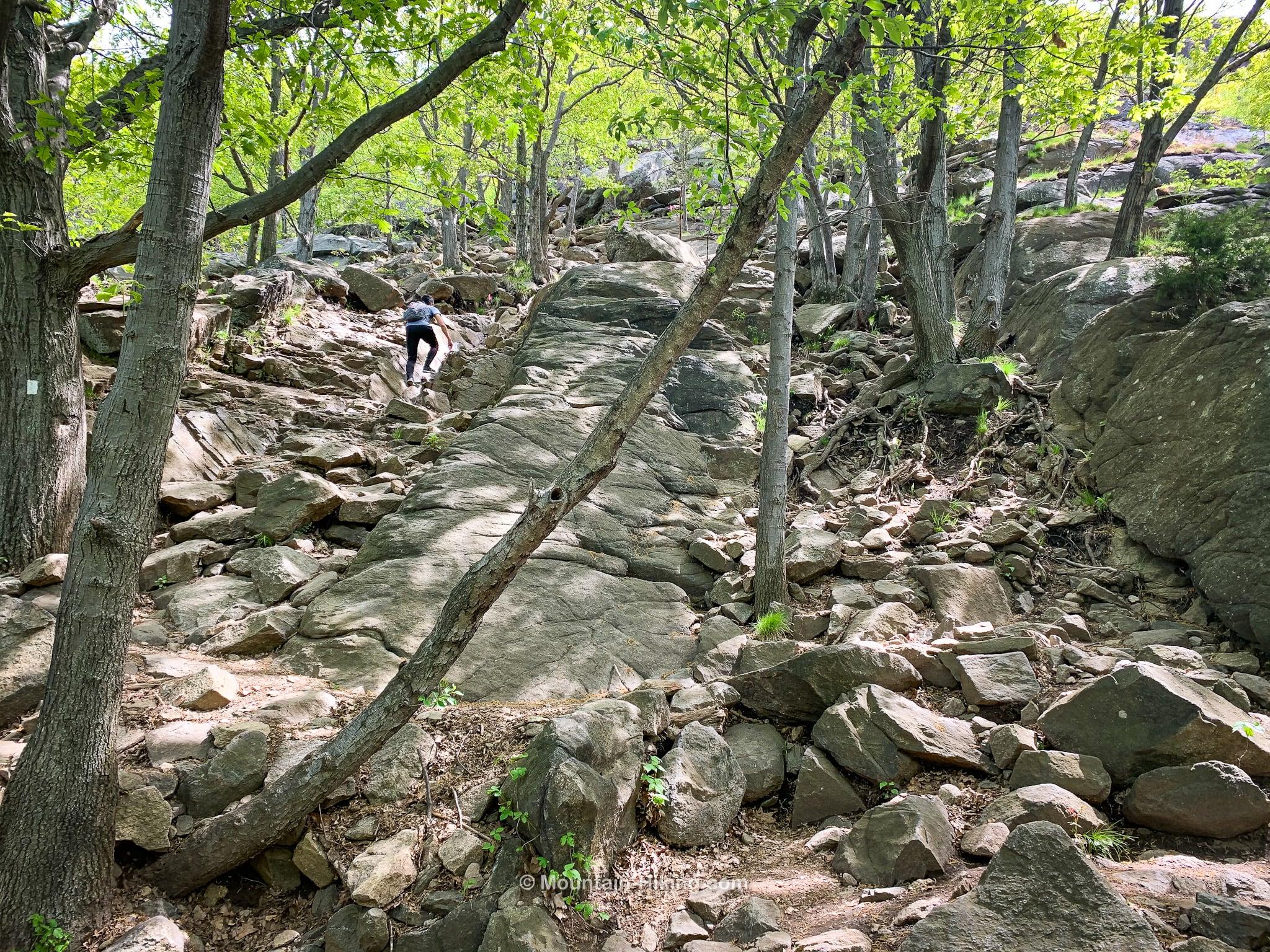 hiker on rocky incline on Breakneck Ridge