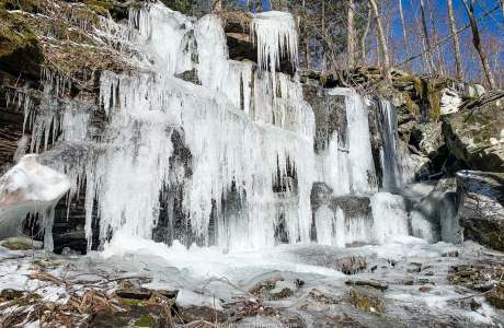 icicles hanging from rock wall