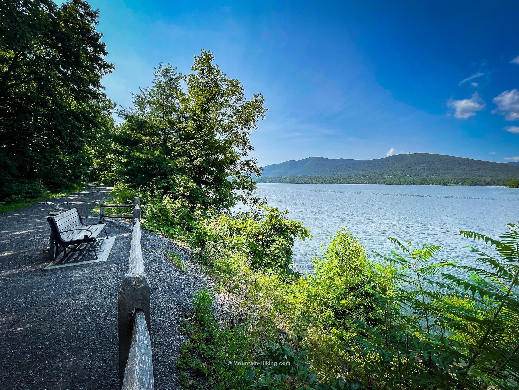 Ashokan Rail Trail wooden bench beside reservoir with mountain views