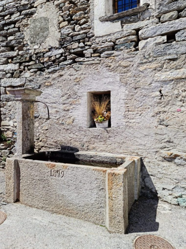 Stone fountain in Corippo dated 1879, though the town was first mentioned in 1224