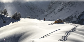 Brady Schlichting sking, snowmobiling, and winter camping near Vail, Colorado.