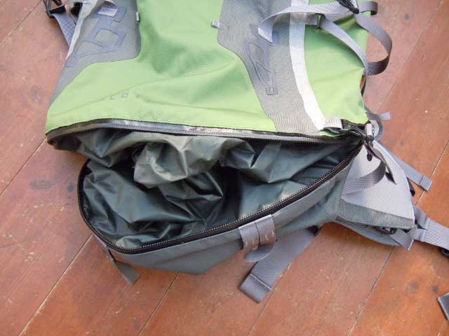 Waterproof zip into lower compartment. Note the floppy divider that can either keep wet and dry stuff separate, or be flattened into the bottom of the bag allowing 1-compartment use.