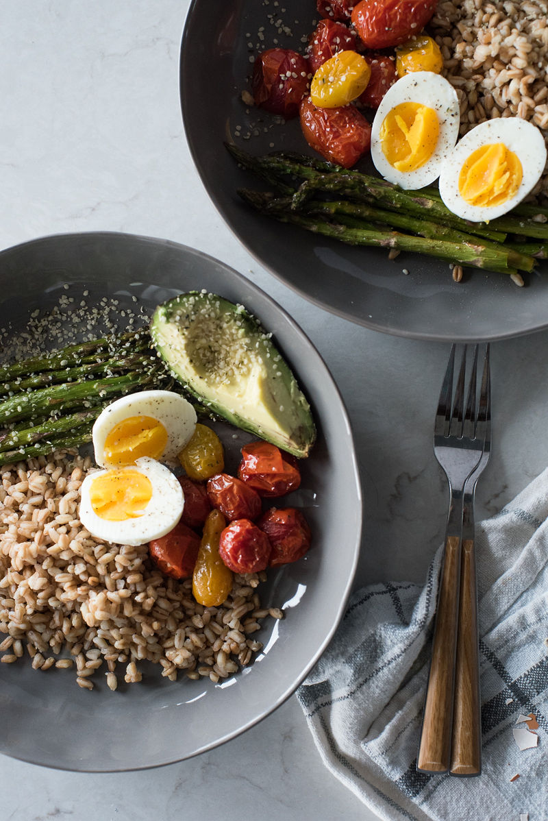 breakfast bowl with farro, soft boiled egg, and roasted veggies
