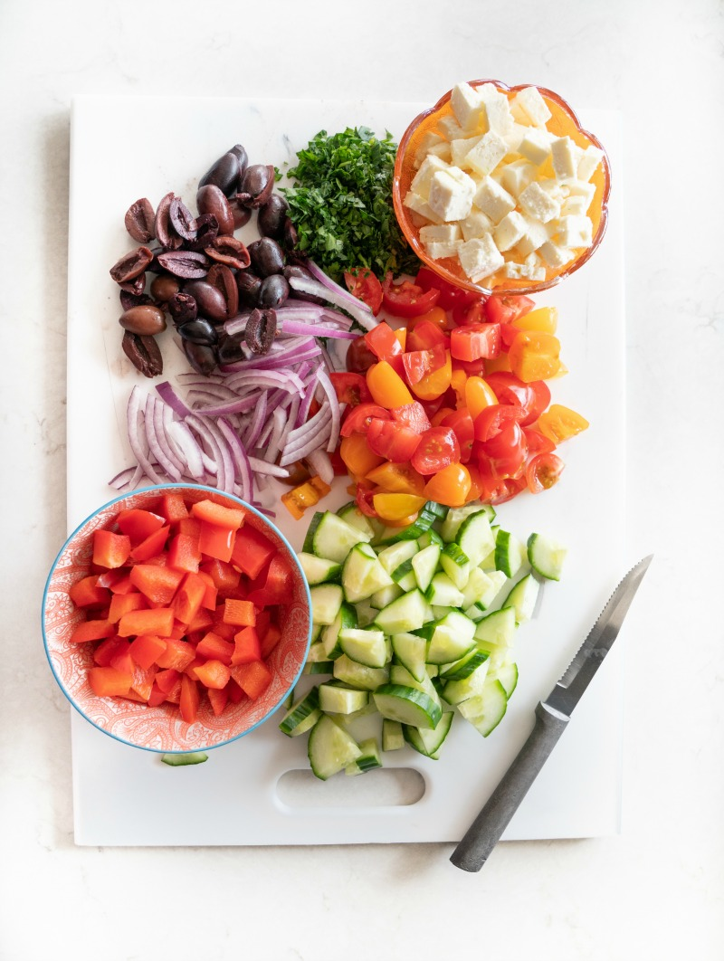 All the makings for the best Greek Pasta salad. www.mountainmamacooks.com