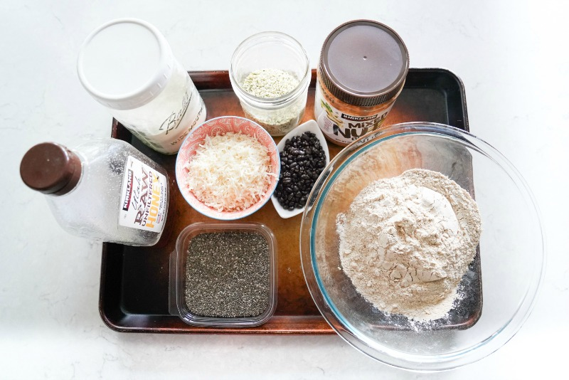 All the ingredients laid out on a baking sheet to make my favorite protein bites- cinnamon oat!