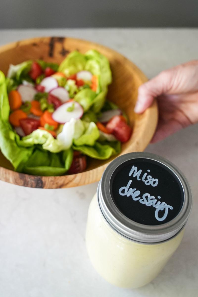 A mason jar of miso dressing