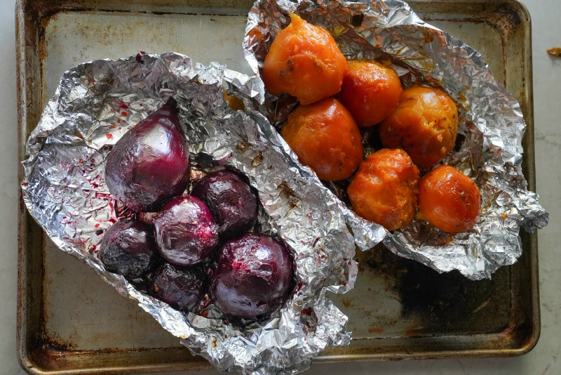 Roasted beets that have just come out of the oven. They're cooling and will be peeled and pickled. www.mountainmamacooks.com