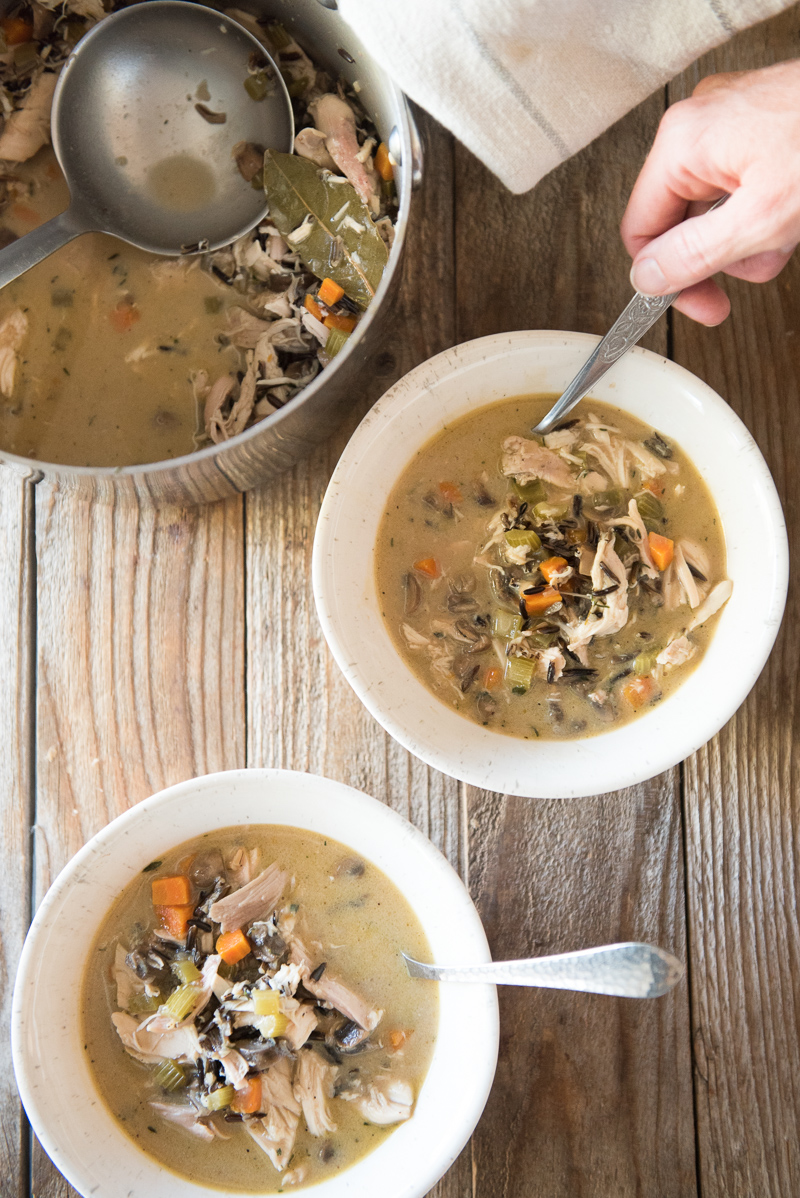 Chicken and wild rice soup recipe is a spin on one of the most popular recipes on my blog using leftover Thanksgiving turkey for a turkey and rice soup. www.mountainmamacooks.com