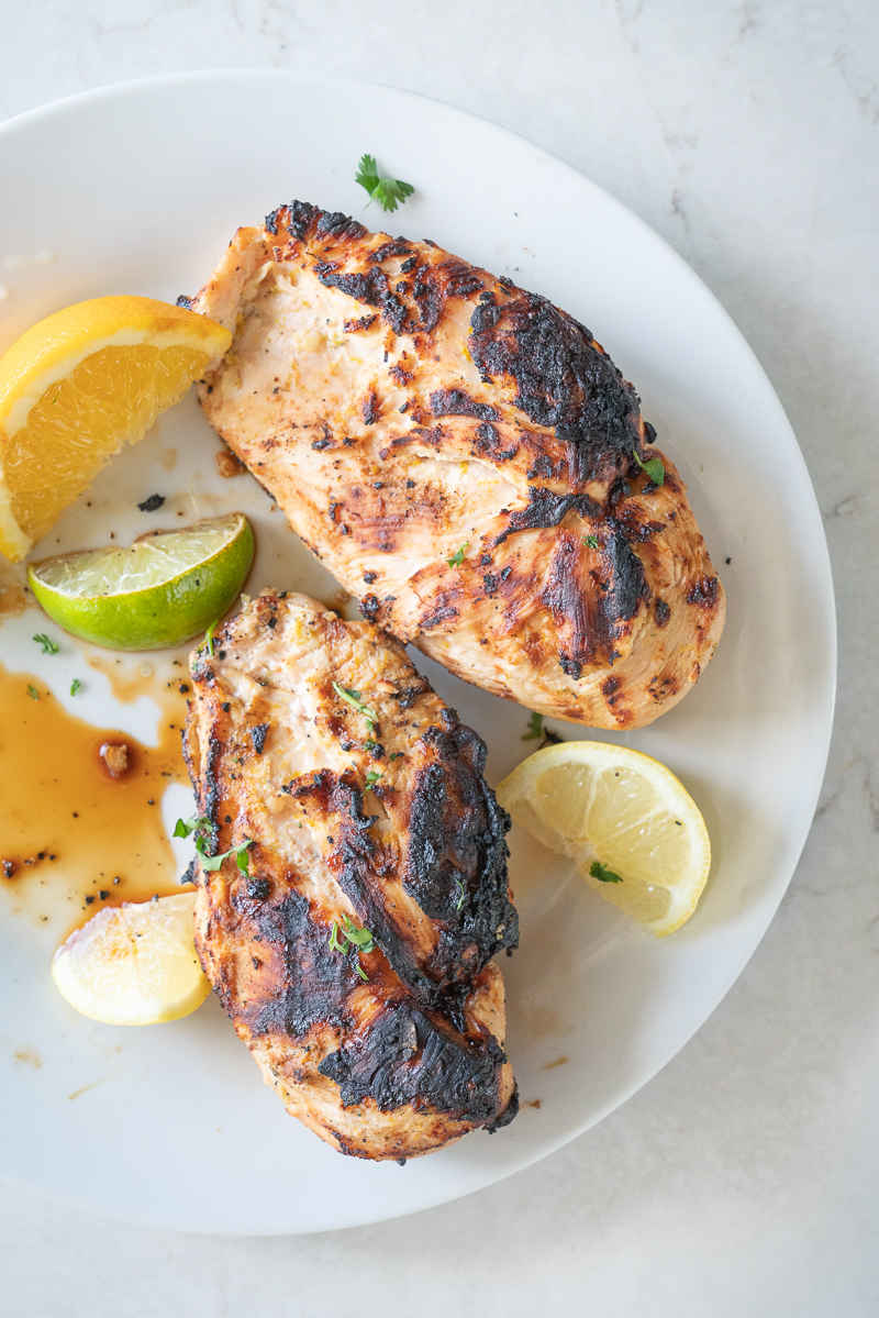 My go to grilled chicken recipe is loaded with garlic and mixed citrus. It's delicious! www.mountainmamacooks.com