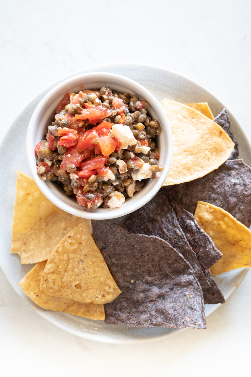 Easy, 3-ingredient Trader Joes lentil dip served with tortilla chips. www.mountainmamacooks.com