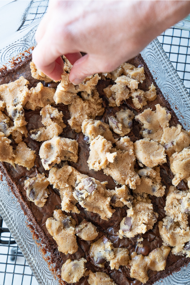 After par baking the brownies I add clumps of chocolate chip cookie dough and then bake into a delicious hybrid bar. www.mountainmamacooks.com