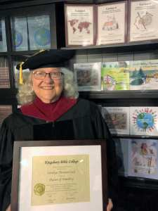 Local teacher earns doctorate degree at 73