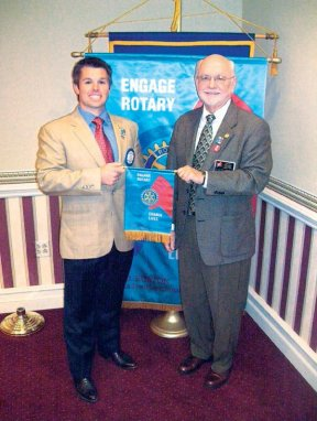 """Lewisburg Rotary President Paul Grist and District Governor Harry Faulk display this year's district Rotary theme of """"Engage Rotary, Change Lives"""""""