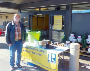 Fred Ray working the Feed The Need Community Food Drive table at Kroger in Ronceverte